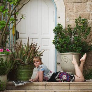 Tijana Kondic lying on the stairs reading a managazine