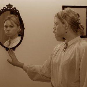 Tijana Kondic looking at herself in the mirror